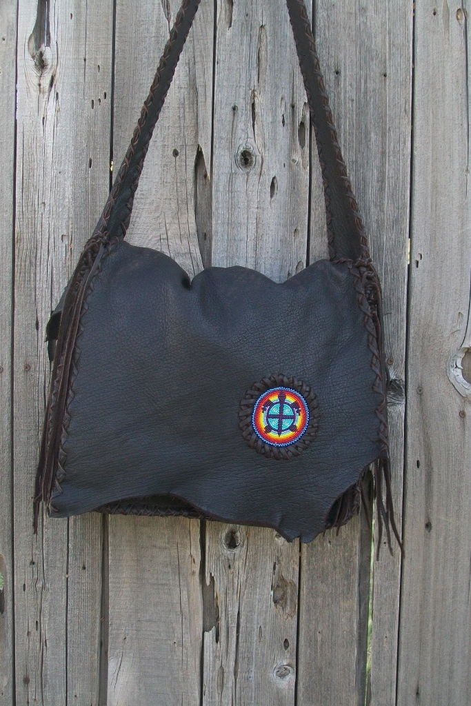 LEATHERMESSENGER BAG WITH A BEADED TURTLE BAG