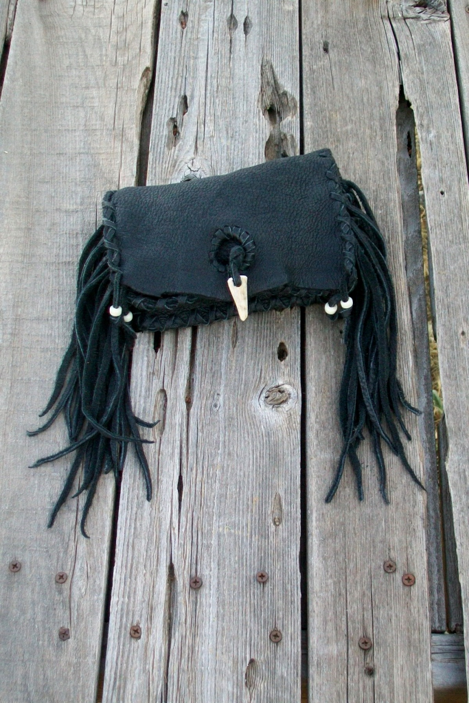 Unique black leather clutch.