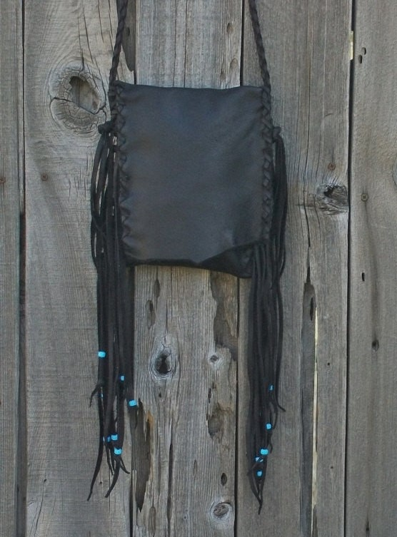 Fringed leather bag