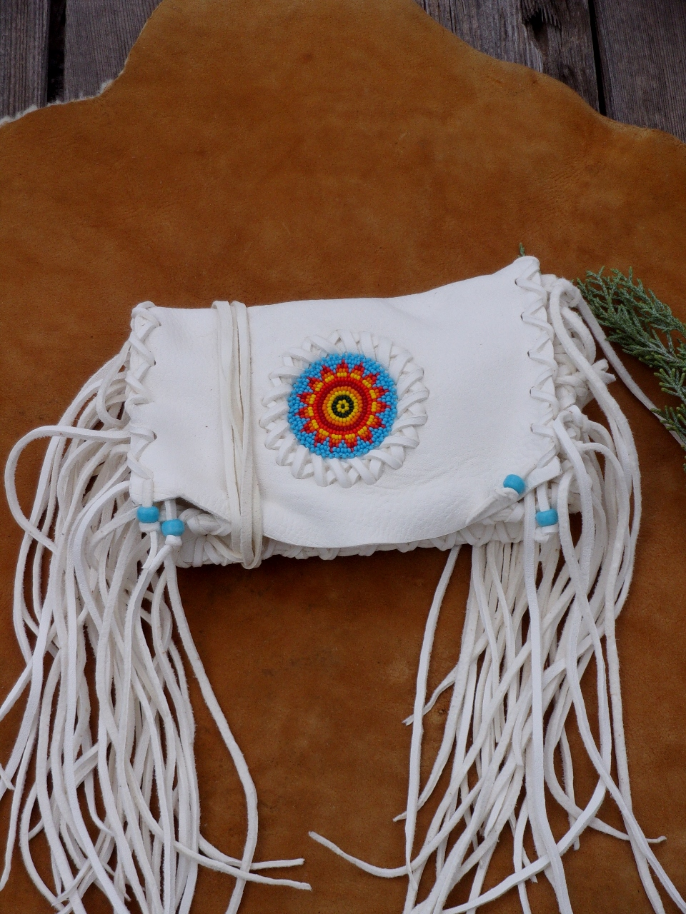 White fringed beaded leather clutch