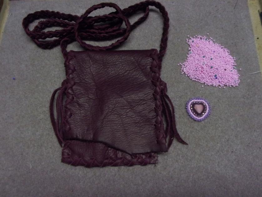 beaded burgundy leather bag