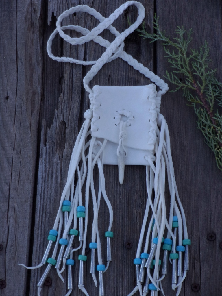 fringed white buckskin bag