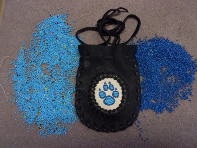 beaded wolf paw bag