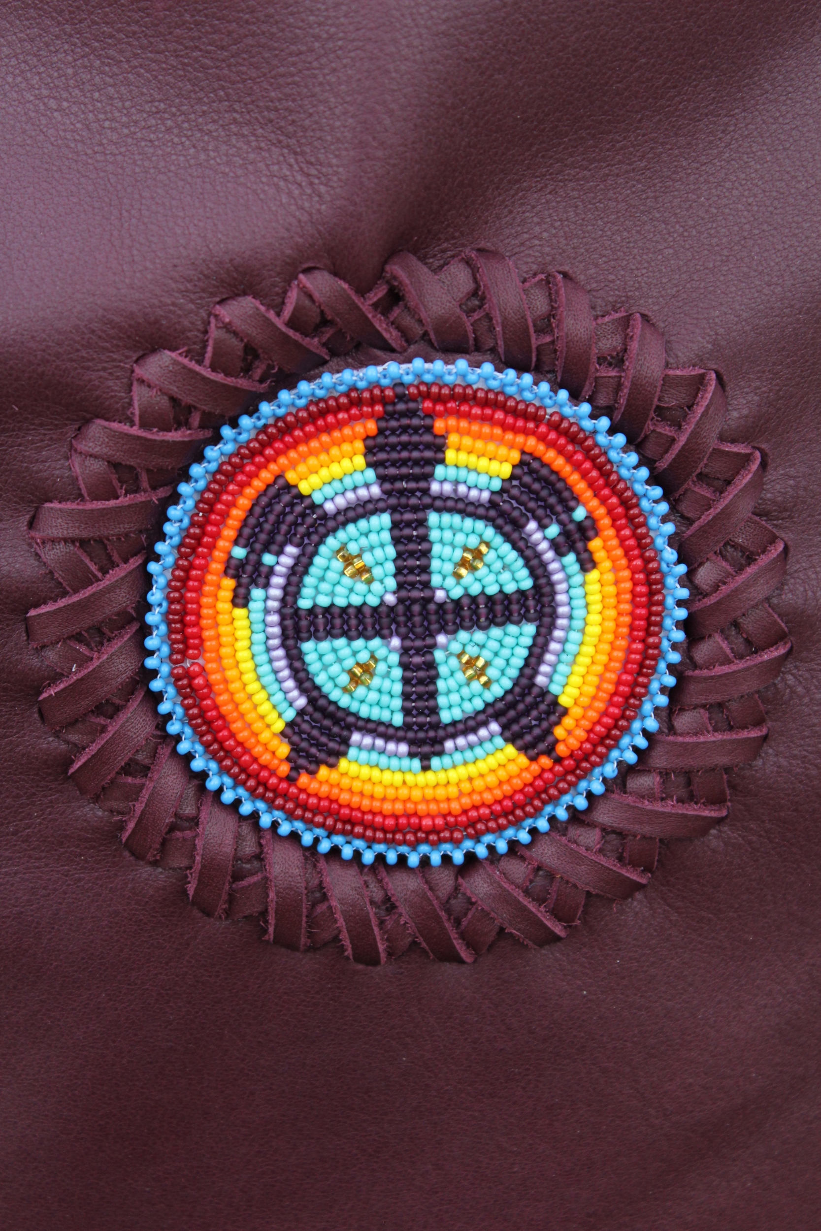 A beaded turtle done in rainbow colors.