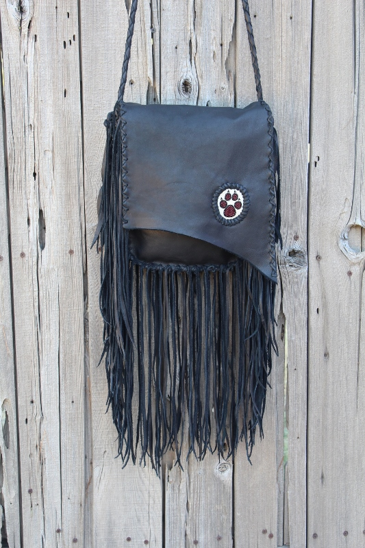 Beaded wolf paw fringed handbag