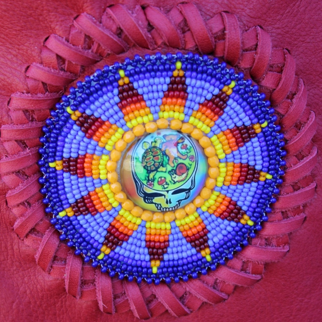 Red leather handbag with Grateful Dead stealie beadwork